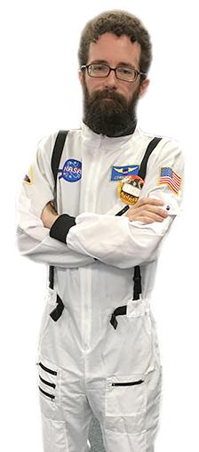 Assisstant manager Jeff Dixon emulates an astronaut for Spirit Halloween's Saturday employee dress up day.