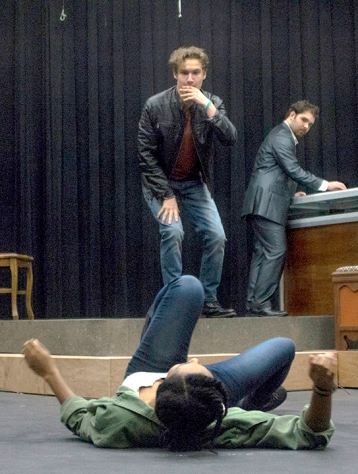 Eric Rozell stands over Sydney Haygood during the reversal of Mauritius in Lamar University's Studio Theater, Oct. 2
