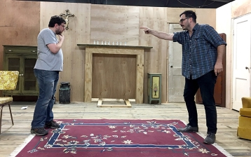 """Michael Saar, left, and Michael Mason rehearse a scene from Ad Hoc's """"The Lonesome West,"""" which opens Friday at The Art Studio, Inc. UP photo by Olivia Malick."""