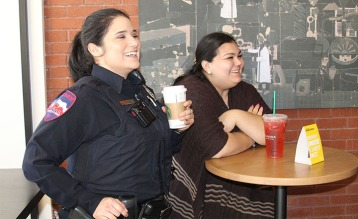 LUPD officer Bianca Tristan (left) enjoys a caramel macchiato with her colleagues, Friday, in the new Starbucks located in the lobby of Gray Library.