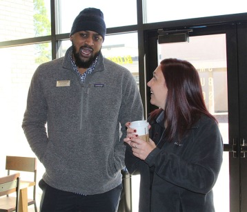 Chris Harpe, director of dining services at Lamar, and a fellow colleague chat about the new addition to campus over hot coffee, Friday, in the new Starbucks located in the lobby of Gray Library.