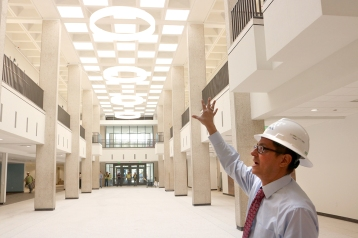 Dr. Terry Mena, Dean of Students, points out all of the natural light in the newly renovated Setzer Student Center. UP photo by Hannah LeTulle