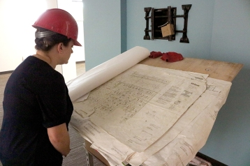 Marketing Coordinator, Elizabeth Jeanes, looks over the blueprint for the newly renovated Setzer Student Center.